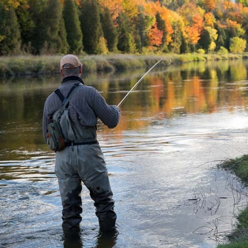man fly fishing waders