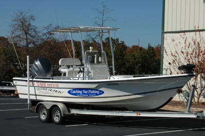fishing guide boat with fishmaster t-top