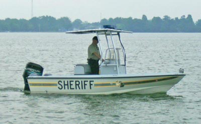 boston whaler sheriff boat with t-top