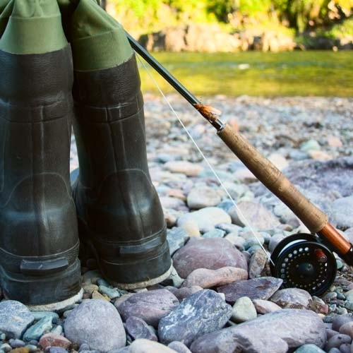 fly fishing boots by water