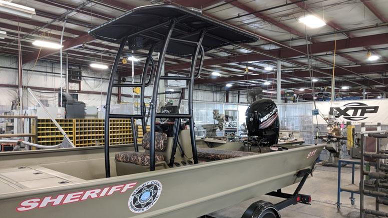 fishmaster powder coating t-top on sheriff boat